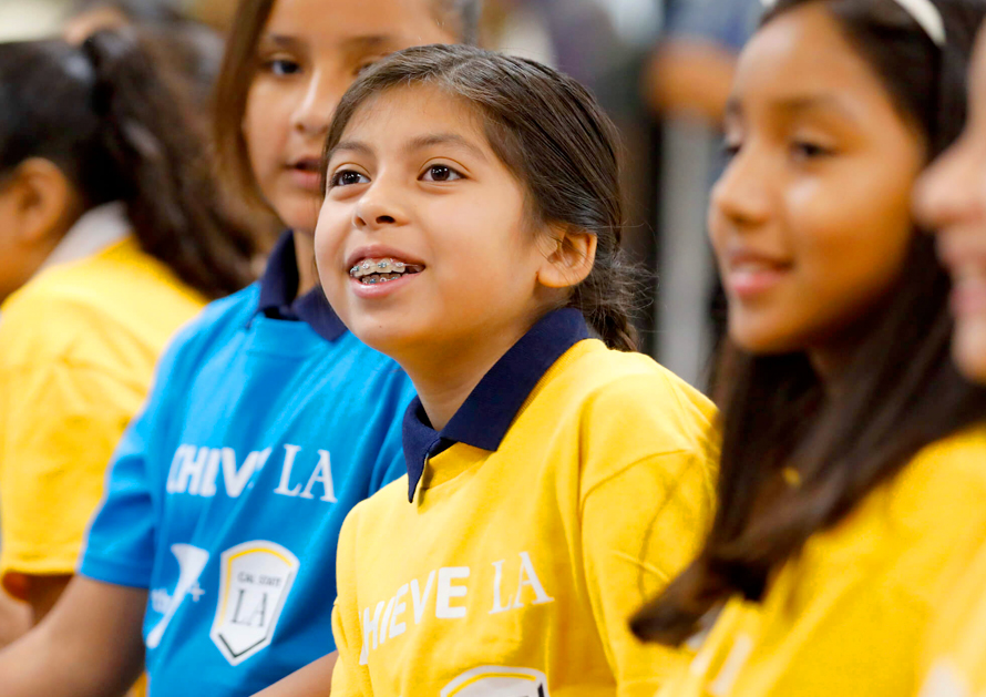 Young students celebrate the launch of Achieve LA, a partnership between Cal State LA and the YMCA.
