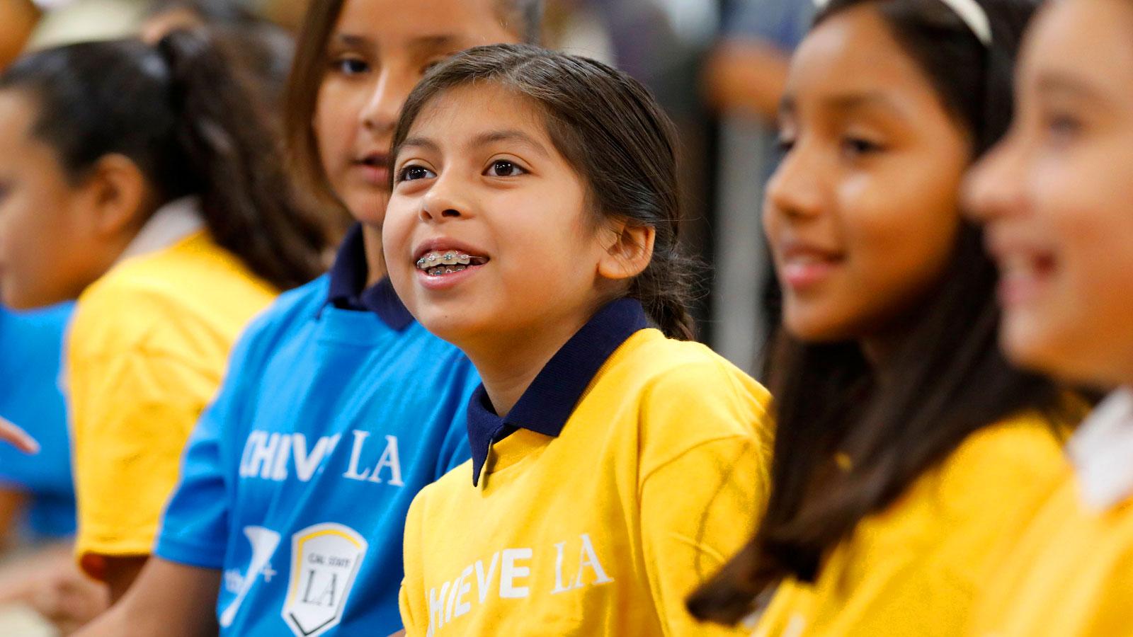 Students listen as Mayor Eric Garcetti announces Achieve LA.