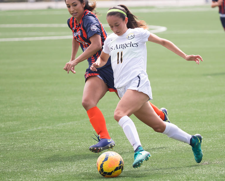 Paulina Chaidez dribbles past opposing defender.