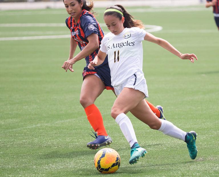 Paulina Chaidez dribbles past opposing defender.