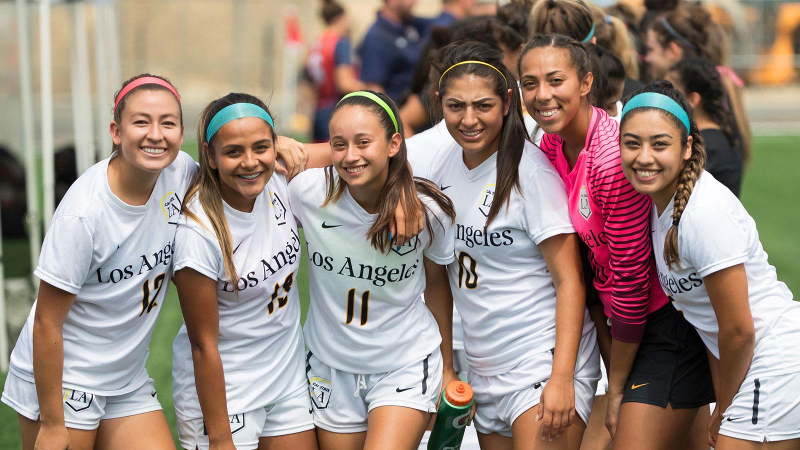 Paulina Chaidez poses for the camera with Erika Lizarraga, Meranda Salazar, Zarette Munoz-Aguilar, Adriana Maldonado, and Valerie Mares.