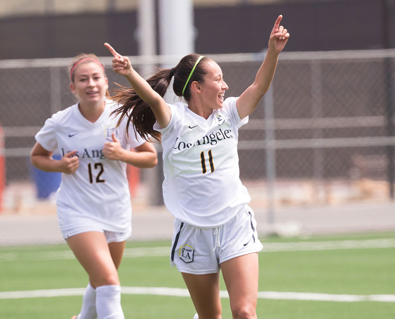 Paulina Chaidez celebrates a victory on the field with her teammates.
