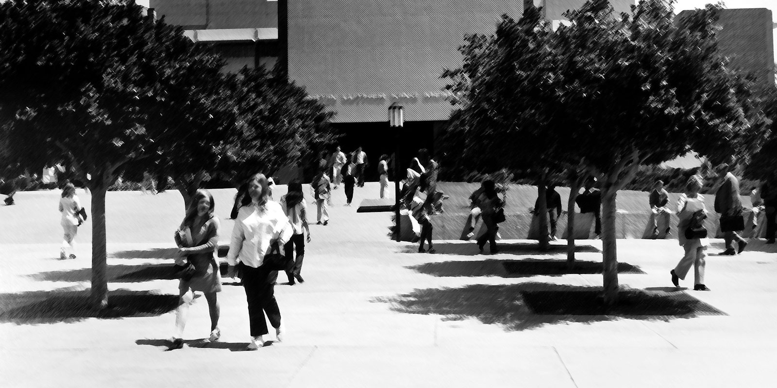 Cal State LA students from the 1960s walking by King Hall